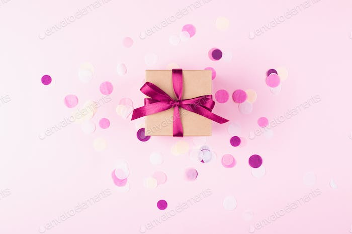 Gift Box and Confetti on Pink Background.