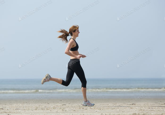 Woman runner enjoying exercise at the beach