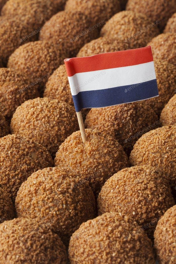 Dutch traditional snack bitterballen full frame with a dutch fla