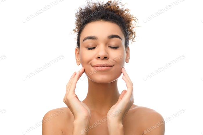 Clean face of beautiful girl, lady touching her cheeks