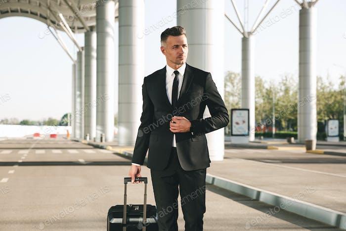 Confident businessman dressed in suit
