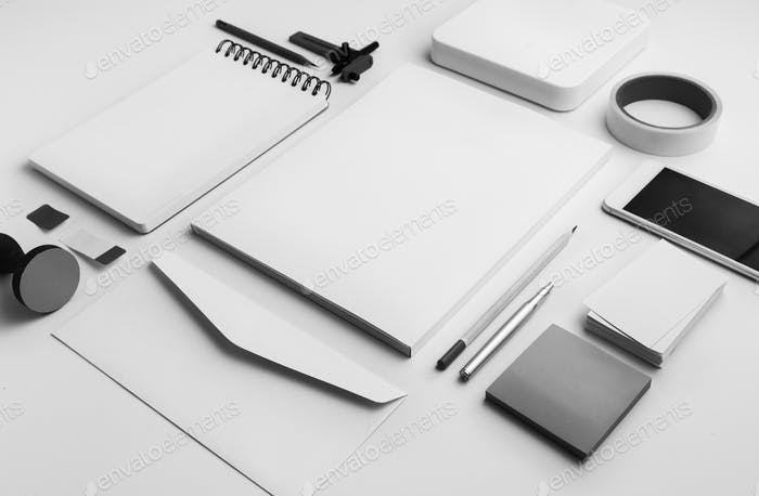 Closeup of paper stationery isolated on white table