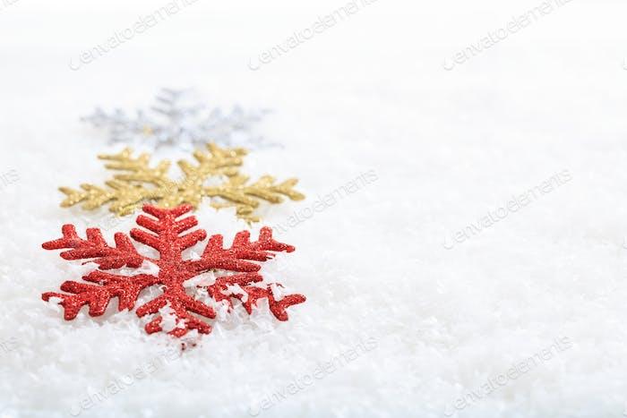 Snow flakes on snow background
