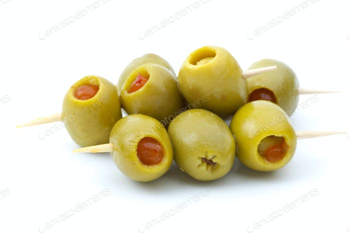 Some olives stuffed with pepper on a wooden toothpicks