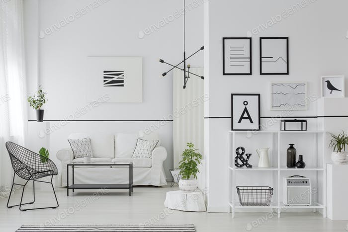 Posters in white apartment interior