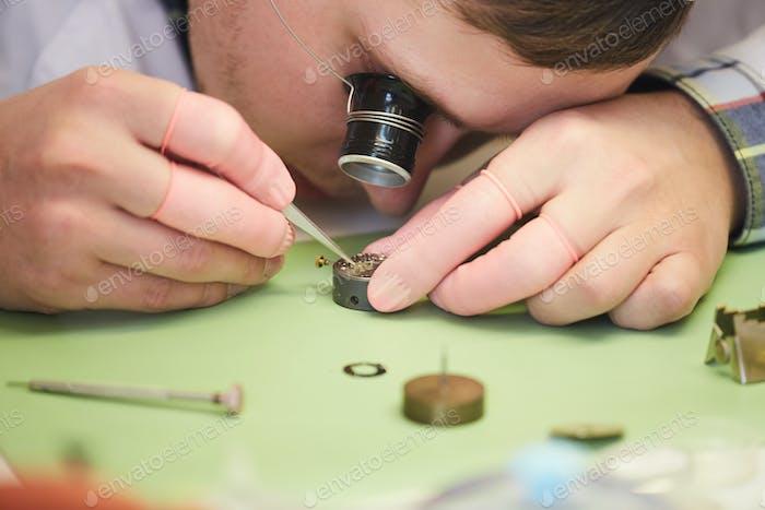Clockmaker Fixing Watch