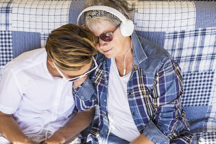 couple young and old grandmother and teenager nephew family time together listen music