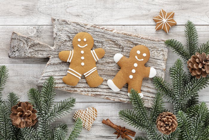 Homemade christmas gingerbread cookies on wooden table.