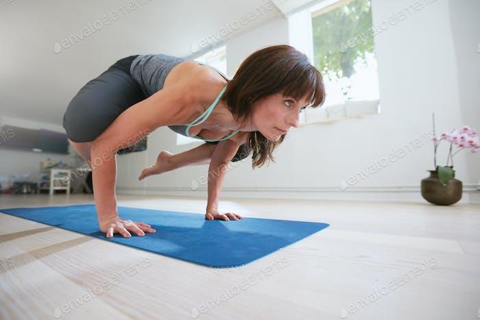 Fitness woman doing yoga handstand - Bakasana