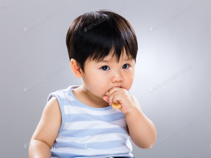 Asian baby boy with finger food