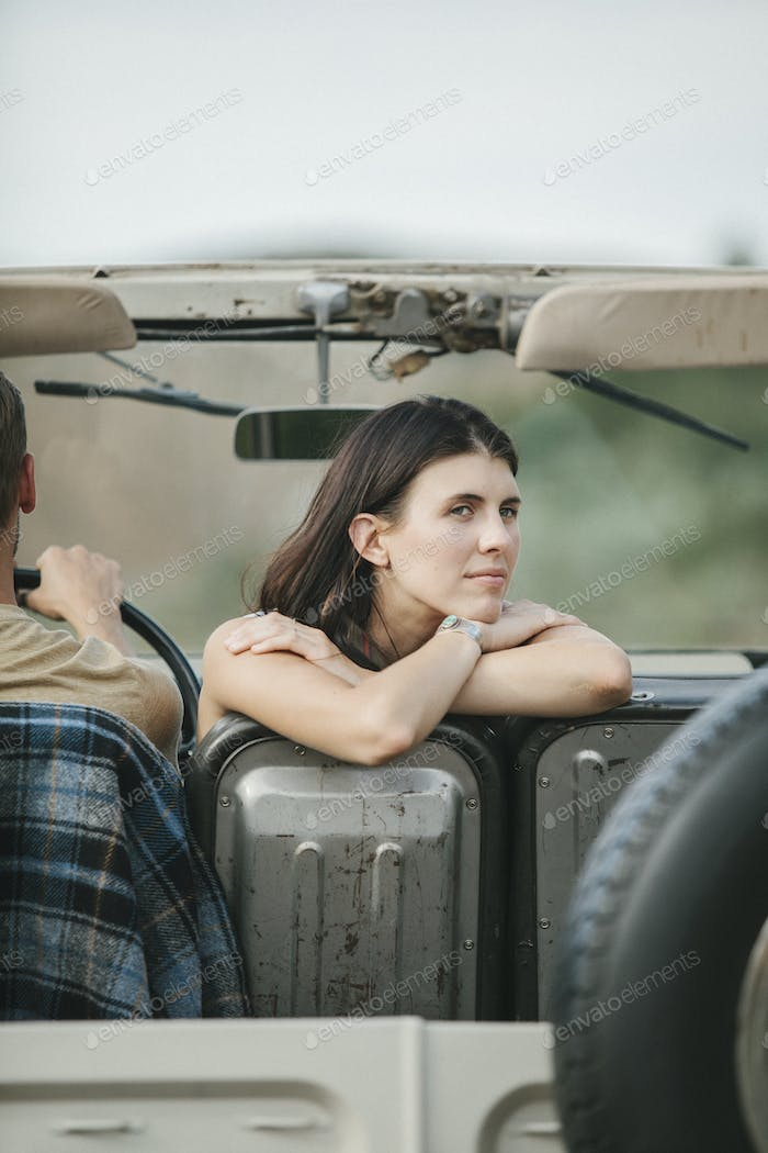 A couple on a road trip in the mountains.