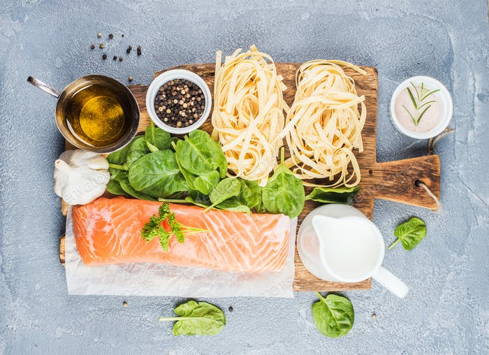 Ingredients for cooking pasta tagliatelle with salmon, spinach and cream