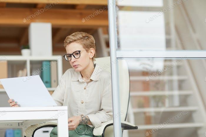 Successful Businesswoman Reading Document