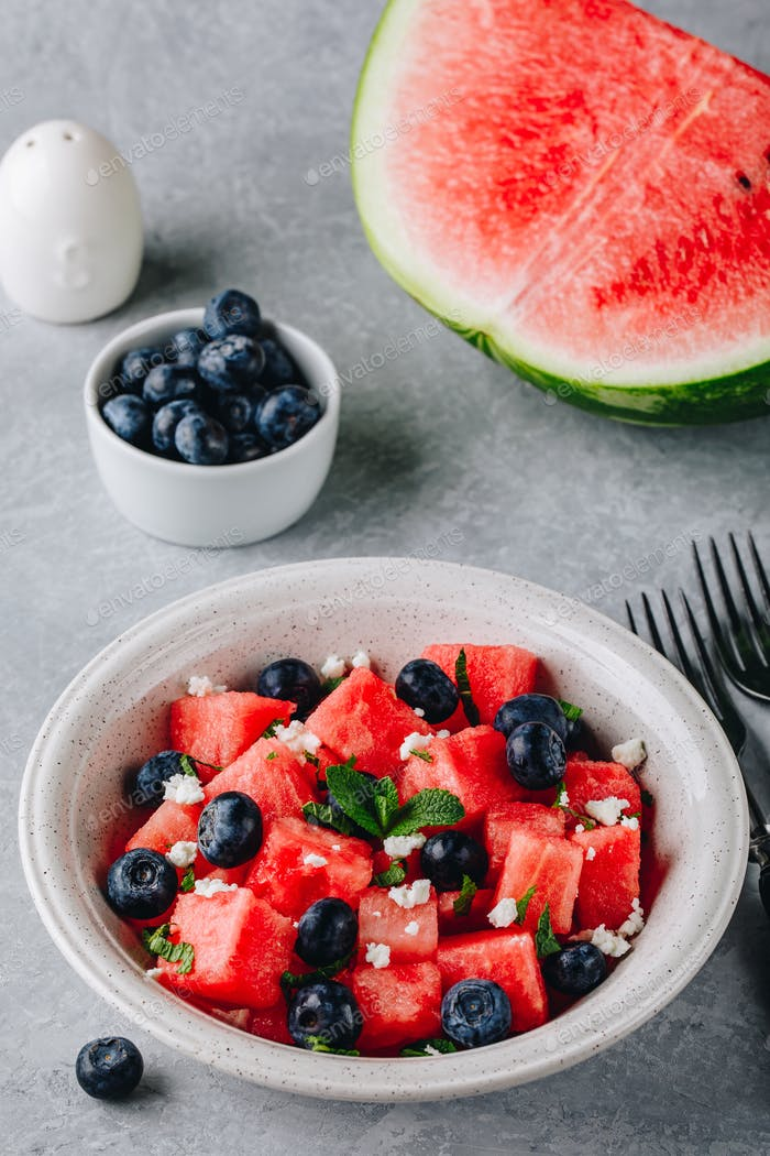 Fruit salad with watermelon, blueberries, feta cheese and mint.