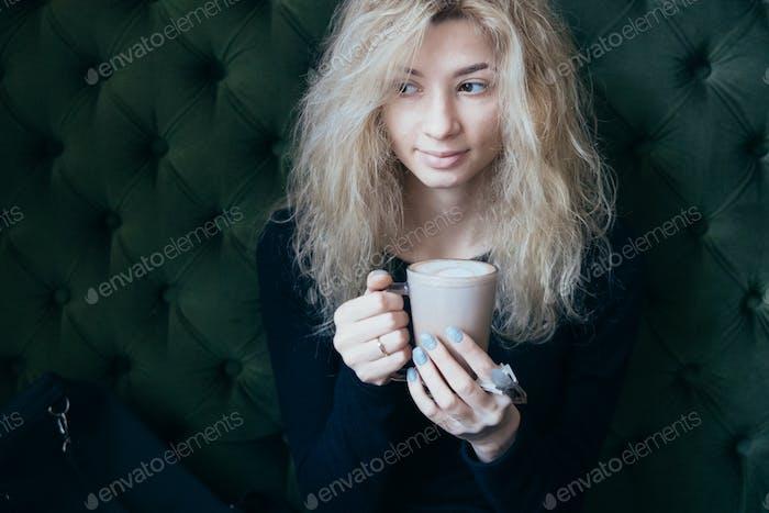 woman holding a coffee mug