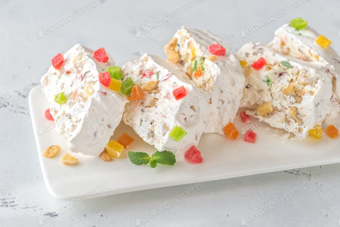 White nougat with fresh mint leaves