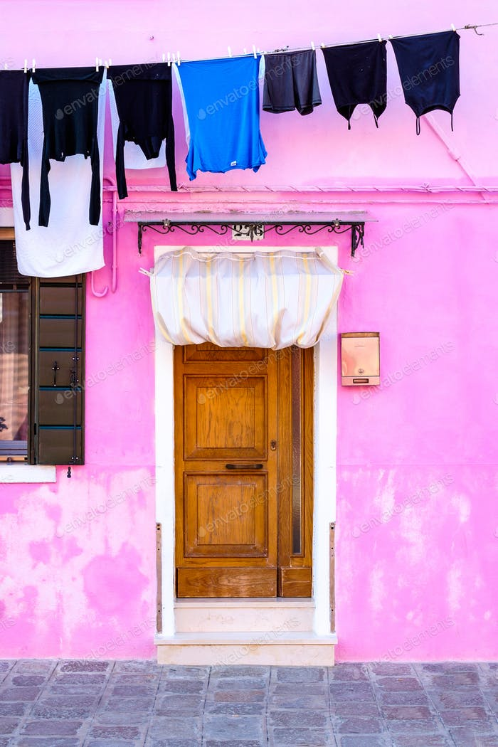 Colorful house and washed clothes on a rack, Burano island, Venice