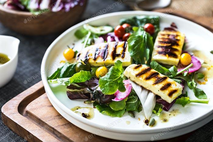 Grilled Halloumi on fresh salad  with Orange Vinaigrette