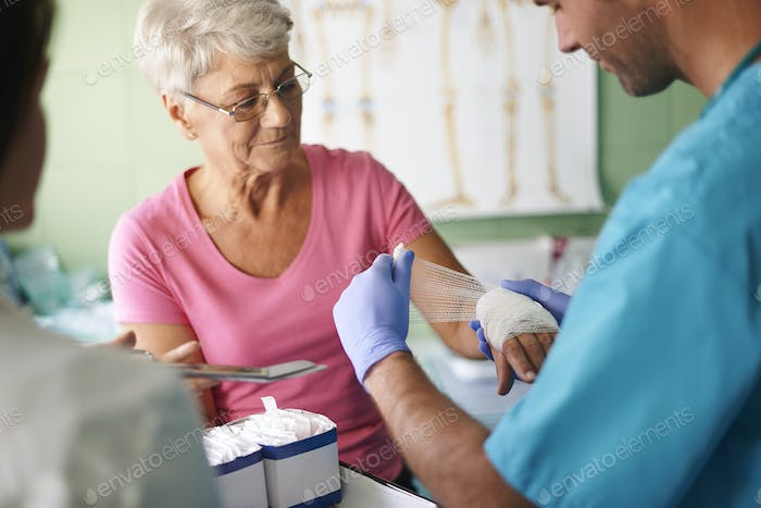 Senior woman with bandage on the hand