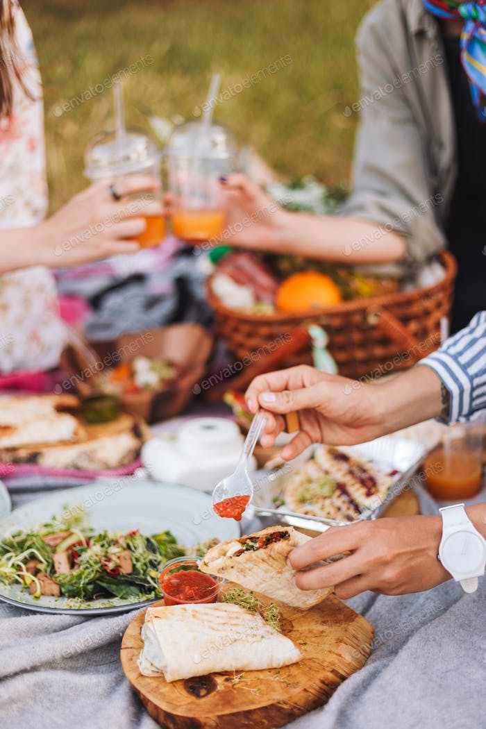 Close up beautiful picnic with variety of tasty food and drinks