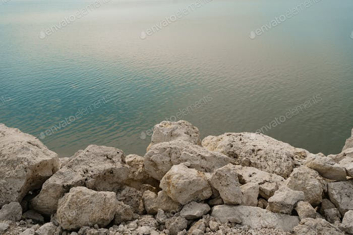 White rocks in water background