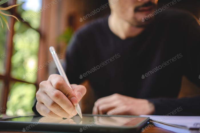 using professional digital tablet technology to write a business work, modern online screen