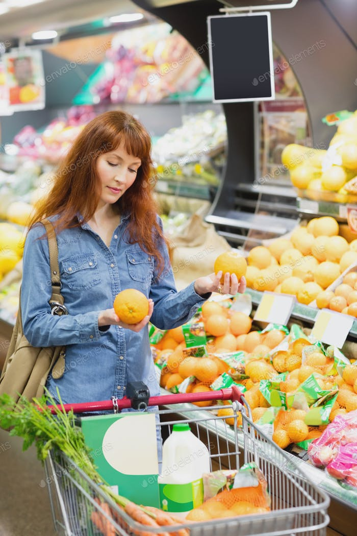 Customer holding oranges