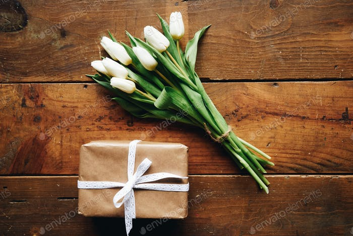 White tulips bouquet and gift box