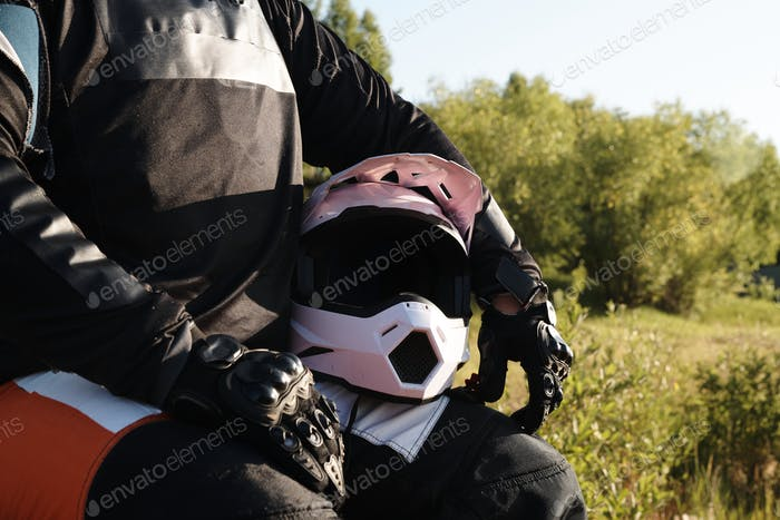 Motorcyclist with helmet