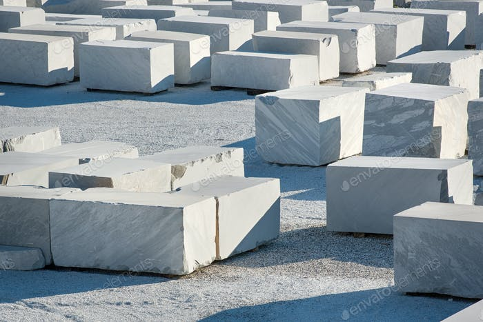 Large rectangular blocks of white Carrara marble