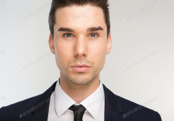 Handsome young business man with necktie