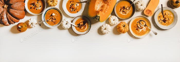 Pumpkin cream soup with cream, seeds and croutons, copy space