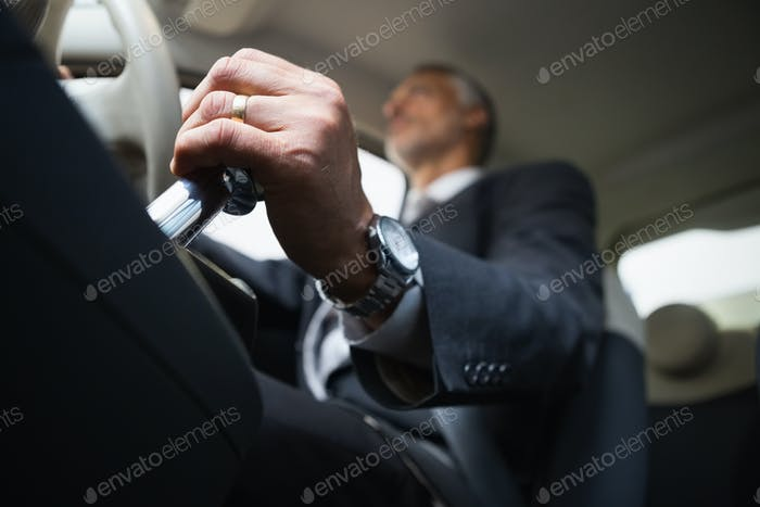 Man using a gear stick in a car dealership at new car showroom