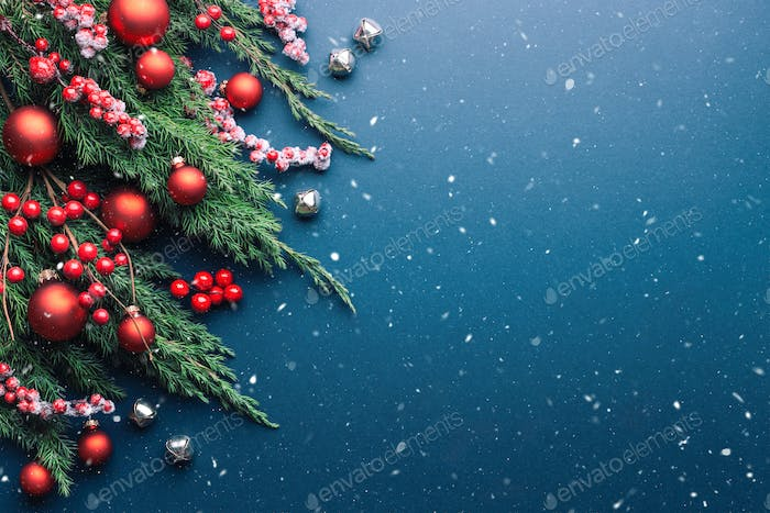 Christmas Background with Spruce Branches and Decorations.