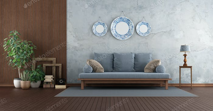Retro living room with sofa against old wall