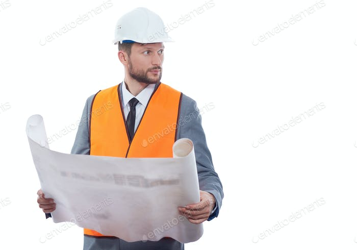 Engineer in orange vest reading drawing plan
