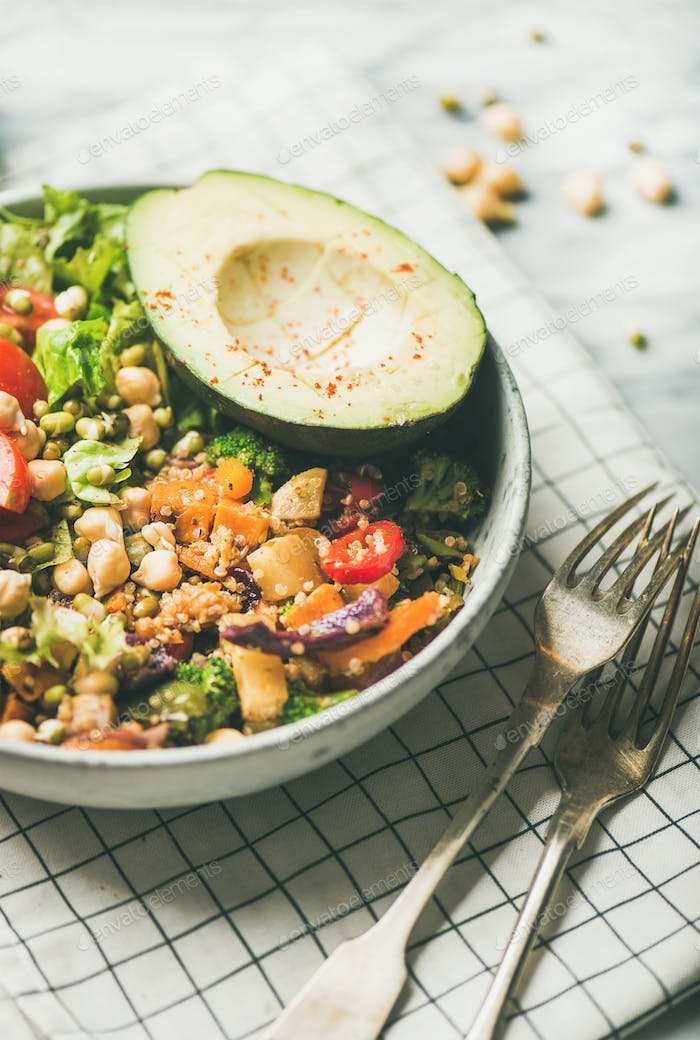 Vegan dinner with avocado, grains, beans and vegetables