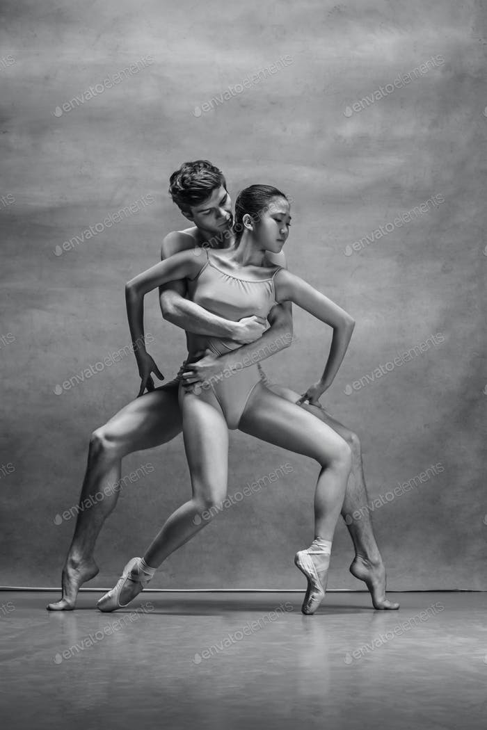 Thumbnail for Couple of ballet dancers posing over gray background