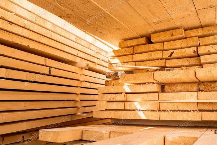 Stack of construction wood planks prepared for build a house