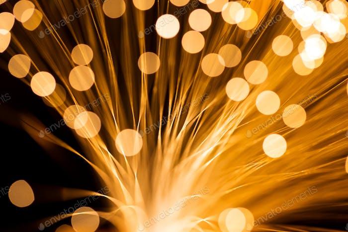 Golden fibre optic strands