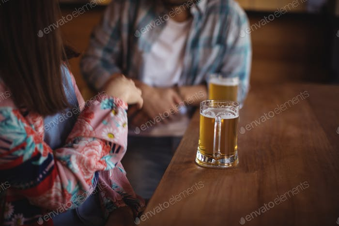 Couple having beer at counter