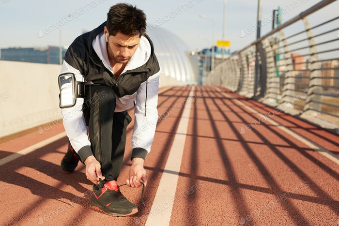 Jogger on racetrack