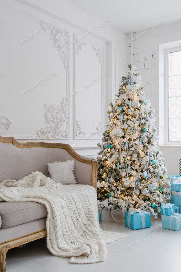 Calm image of interior luxury home living room decorated christmas tree and gifts, sofa covered with