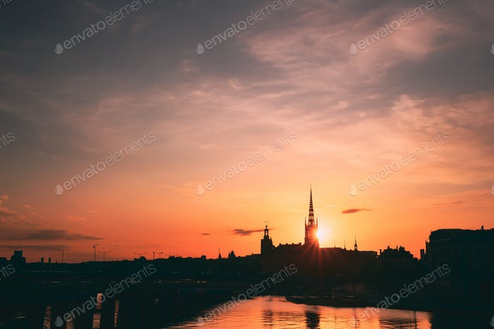 Stockholm, Sweden. Sunset Sun Shine Through Dark Silhouette Of Riddarholm Church In Stockholm