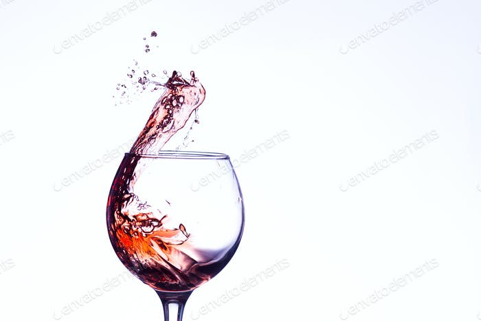 Wine splashing in glass
