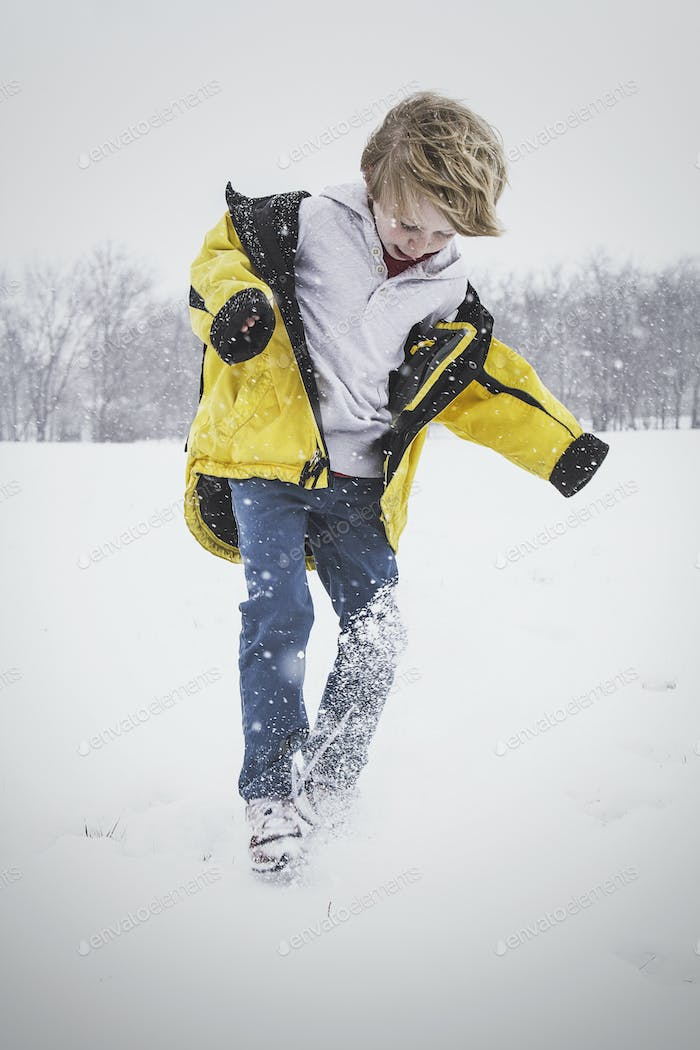 Child Jumping in the Snow