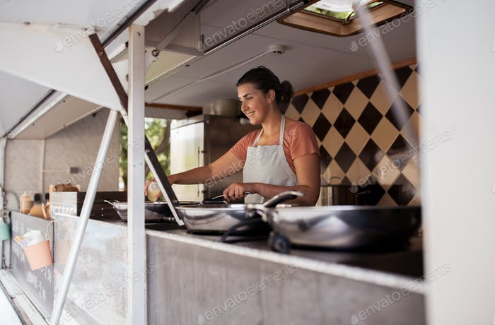 happy chef or seller cooking at food truck