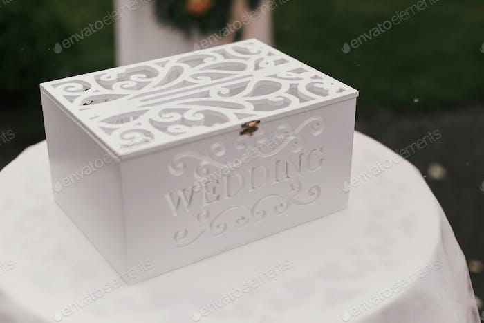 Stylish white wooden box with wedding word