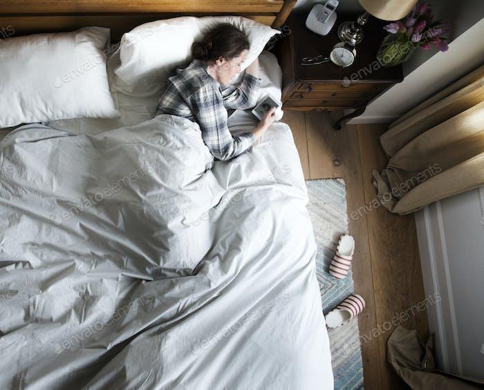 Caucasian woman sleeping with music