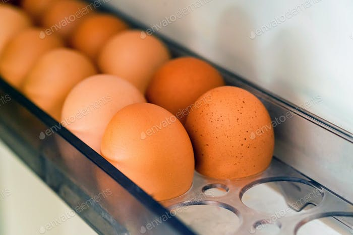 Close-up of fresh farm brown eggs in frig